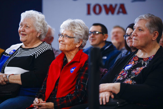 Attendees listen to Democratic presidential candidate former Vice President Joe Biden speak during a campaign event at the University of Northern Iowa, Monday, Jan. 27, 2020, in Cedar Falls, Iowa. (AP Photo/Matt Rourke)