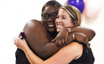 ADVANCE FOR PUBLICATION ON SUNDAY, MAY 16, AND THEREAFTER - After adopting MonyayFaithPaskalides, left, LeahPaskalides, right, gives her a big hug, April 27, 2021, in Bradenton, Fla. (Earle Kimel/Sarasota Herald-Tribune via AP)