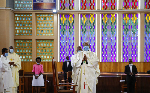 Priests conduct a service without a congregation, but which was broadcast on television, at the Cathedral Basilica of the Holy Family in Nairobi, Kenya, on Easter Sunday, April 12, 2020. The new coronavirus causes mild or moderate symptoms for most people, but for some, especially older adults and people with existing health problems, it can cause more severe illness or death. (AP Photo/Brian Inganga)