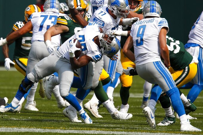 Green Bay Packers' Za'Darius Smith is called for a facemask penalty on Detroit Lions' Kerryon Johnson during the first half of an NFL football game Sunday, Sept. 20, 2020, in Green Bay, Wis. (AP Photo/Matt Ludtke)