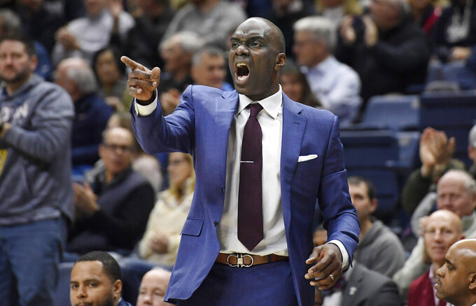 Temple head coach Aaron McKie reacts in the first half of an NCAA college basketball game against Connecticut, Wednesday, Jan. 29, 2020, in Storrs, Conn. (AP Photo/Jessica Hill)