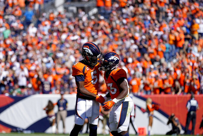Denver Broncos running back Javonte Williams (33) celebrates his touchdown against the New York Jets with quarterback Teddy Bridgewater (5) during the first half of an NFL football game, Sunday, Sept. 26, 2021, in Denver. (AP Photo/Jack Dempsey)