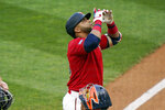 Minnesota Twins' Nelson Cruz celebrates after his solo home run off Houston Astros pitcher Jose Urquidy as he scores in the first inning of a baseball game, Friday, June 11, 2021, in Minneapolis. (AP Photo/Jim Mone)