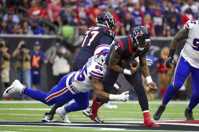 Houston Texans quarterback Deshaun Watson (4) is tackled by Buffalo Bills defensive end Jerry Hughes (55) during the first half of an NFL wild-card playoff football game Saturday, Jan. 4, 2020, in Houston. (AP Photo/Eric Christian Smith)