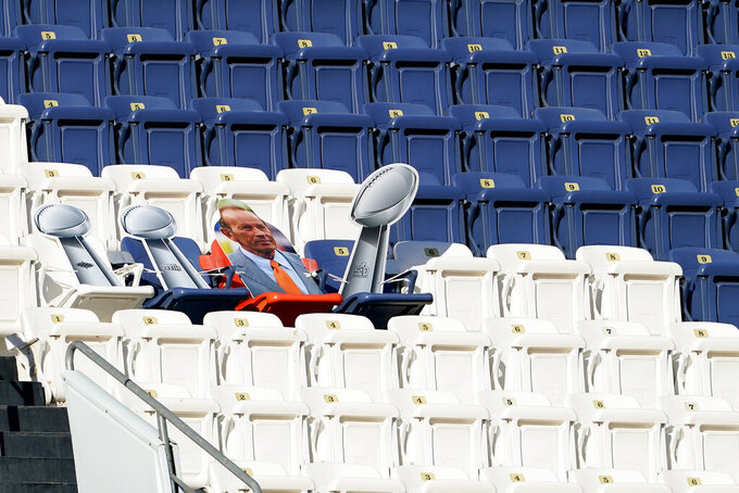 A cut out of the Denver Broncos three Super Bowl trophies and late owner Pat Bowlen sit in the stands during the first half of an NFL football game against the New Orleans Saints, Sunday, Nov. 29, 2020, in Denver. (AP Photo/Jack Dempsey)