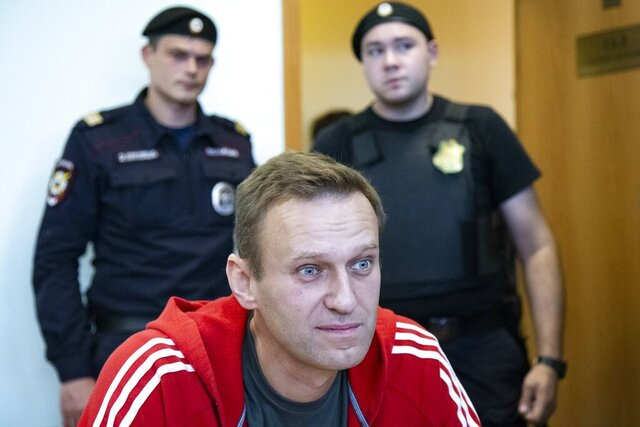 FILE In this file photo taken on Thursday, Aug. 22, 2019, Russian opposition leader Alexei Navalny speaks to the media prior to a court session in Moscow, Russia. German Chancellor Angela Merkel says Russian opposition leader Alexei Navalny was the victim of an