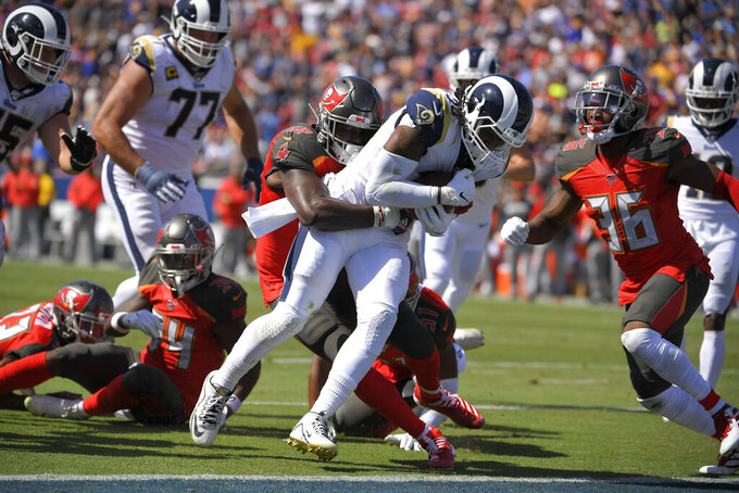 Los Angeles Rams running back Todd Gurley scores past Tampa Bay Buccaneers linebacker Shaquil Barrett during the first of an NFL football game Sunday, Sept. 29, 2019, in Los Angeles. (AP Photo/Mark J. Terrill)