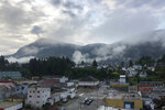 In this July 19, 2019 photo, morning fog hangs over Prince Rupert, British Columbia, Canada. The town, where whales, grizzly bears and bald eagles are common sights, is among more than a dozen communities along Canada's wild west coast where residents _ many Indigenous _ are living in homes with aging pipes, drinking corrosive rainwater that is likely to draw lead. But their province of British Columbia doesn't require municipalities to test tap water for lead. (Mackenzie Lad/Institute for Investigative Journalism/Concordia University via AP)