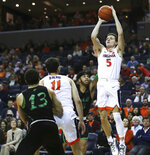 Virginia's guard Kyle Guy (5) shoots over two Marshall defenders in the first half of an NCAA college basketball game on Monday, Dec. 31, 2018, in Charlottesville, Va. (AP Photo/Zack Wajsgras)