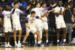 The Northwestern bench celebrates a 3-point basket against Iowa during the first half of an NCAA college basketball game Tuesday, Jan. 14, 2020, in Evanston, Ill. (AP Photo/David Banks)