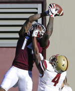 Virginia Tech receiver Damon Hazelton (14) catches a 26 yard touchdown pass in the first quarter from quarterback Ryan Willis over the defense of Boston College  Hamp Cheevers (4) in the first quarter of an NCAA college football game in Blacksburg Va., Saturday, Nov. 3, 2018. (Matt Gentry/The Roanoke Times via AP)