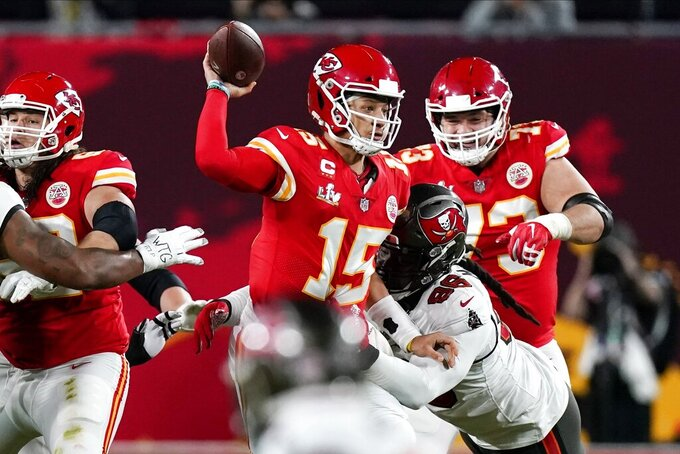 Kansas City Chiefs quarterback Patrick Mahomes runs against the Tampa Bay Buccaneers during the first half of the NFL Super Bowl 55 football game Sunday, Feb. 7, 2021, in Tampa, Fla. (AP Photo/Mark Humphrey)