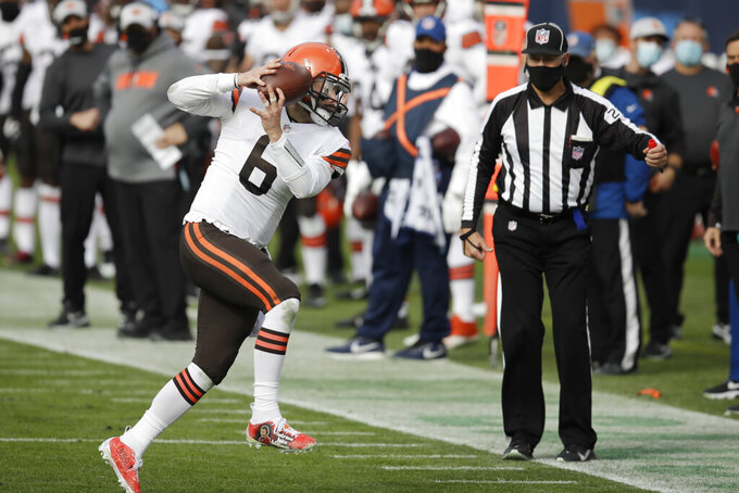Cleveland Browns quarterback Baker Mayfield (6) catches a pass against the Tennessee Titans in the first half of an NFL football game Sunday, Dec. 6, 2020, in Nashville, Tenn. (AP Photo/Ben Margot)