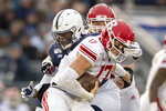 Penn State defensive end Daniel Joseph (49) sacks Rutgers quarterback Johnny Langan (17) in the second quarter of an NCAA college football game in State College, Pa., on Saturday, Nov. 30, 2019. (AP Photo/Barry Reeger)