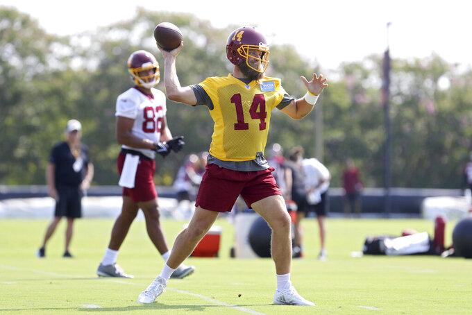 Washington Football Team quarterback Ryan Fitzpatrick (14) throws a pass during NFL football practice in Richmond, Va., Wednesday, July 28, 2021. (AP Photo/Ryan M. Kelly)