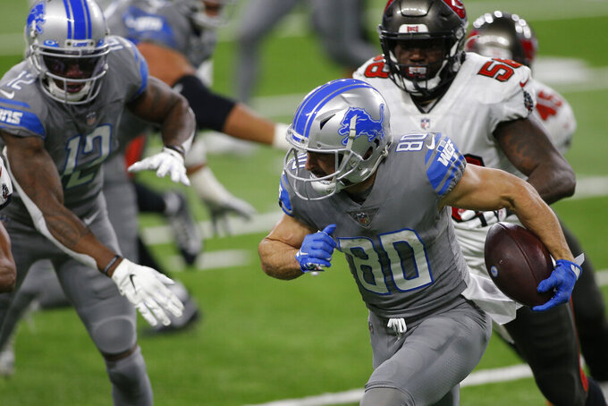 Detroit Lions wide receiver Danny Amendola (80) is chased by Tampa Bay Buccaneers outside linebacker Shaquil Barrett (58) during the second half of an NFL football game, Saturday, Dec. 26, 2020, in Detroit. (AP Photo/Al Goldis)