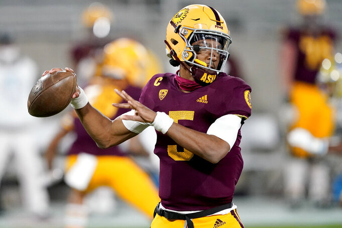 Arizona State quarterback Jayden Daniels (5) looks for a receiver during the first half of the team's NCAA college football game against UCLA, Saturday, Dec. 5, 2020, in Tempe, Ariz. (AP Photo/Matt York)