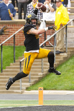 Missouri linebacker Cale Garrett leaps into the end zone after he returned an interception for a touchdown during the second quarter of an NCAA college football game against Troy Saturday, Oct. 5, 2019, in Columbia, Mo. (AP Photo/L.G. Patterson)