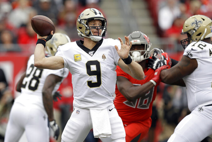 New Orleans Saints quarterback Drew Brees (9) throws a pass against the Tampa Bay Buccaneers during the first half of an NFL football game Sunday, Nov. 17, 2019, in Tampa, Fla. (AP Photo/Chris O'Meara)