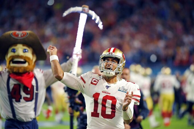 San Francisco 49ers quarterback Jimmy Garoppolo runs onto the field before the NFL Super Bowl 54 football game against the Kansas City Chiefs Sunday, Feb. 2, 2020, in Miami Gardens, Fla. (AP Photo/Mark J. Terrill)