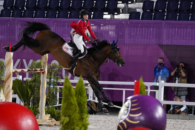 United States' Jessica Springsteen, riding Don Juan van de Donkhoeve, competes during the equestrian jumping individual qualifier during the 2020 Summer Olympics, Tuesday, Aug. 3, 2021, in Tokyo, Japan. (AP Photo/Carolyn Kaster)