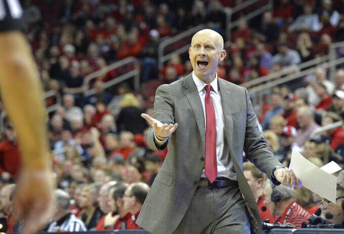 Louisville head coach Chris Mack argues a call with a game official during the second half of an NCAA college basketball game against Boston College in Louisville, Ky., Wednesday, Jan. 16, 2019. Louisville won 80-70. (AP Photo/Timothy D. Easley)