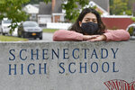Kristina Negron poses for a photograph Tuesday, Sept. 29, 2020, in Schenectady, N.Y.  Negron was laid off from her job as an aide for a special education class at Schenectady High School due to budget cuts.  (AP Photo/Hans Pennink)