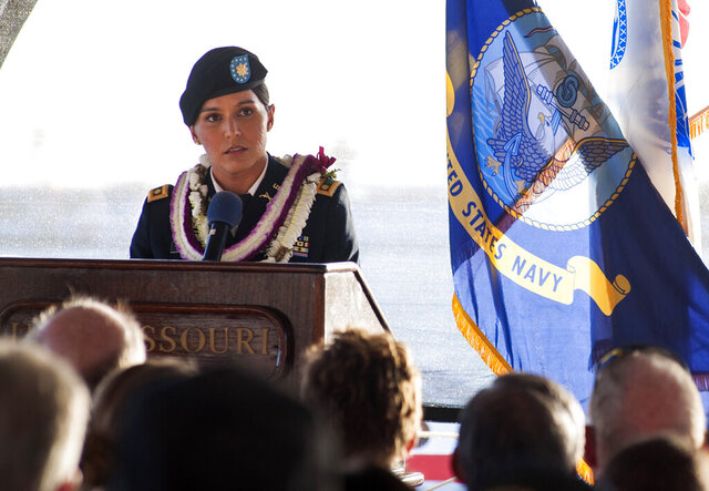 In this Nov. 11, 2015, photo provided by the U.S. Navy, Maj. Tulsi Gabbard, Hawaii Army National Guardsman and U.S. House of Representative for Hawaii's 2nd District, delivers a keynote address to audience members about honoring and remembering veterans of war during a Veterans Day sunset ceremony aboard the Battleship Missouri Memorial at Pearl Harbor, Hawaii. Military officials say Gabbard has left the Hawaii Army National Guard for a new assignment with a California-based Army Reserve unit. The Hawaii National Guard confirmed Gabbard, who holds the rank of major, made the switch in June 2020, but the transfer to an out-of-state unit was not formally announced. (Petty Officer 2nd Class Jeff Troutman/U.S. Navy via AP)