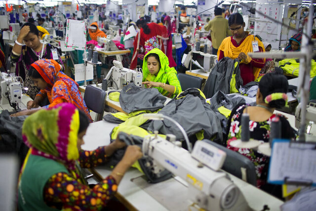 FILE - In this April 19, 2018 photo, Bangladeshis work at Snowtex garment factory in Dhamrai, near Dhaka, Bangladesh. A group set up by European clothing brands that has monitored factory safety in Bangladesh for years plans to leave, with its duties being assumed by a local group including unions and industry figures in the world's second-largest garment manufacturer. The European group and a separate North American group were formed after the collapse of Rana Plaza, a building housing five garment factories that made clothing for international brands. The departure, which officials said Thursday, Jan. 16, 2019, was planned for May, follows a protracted tussle with garment manufacturers who wanted Bangladesh's government to form a local watch group to monitor the sector. (AP Photo/A.M. Ahad, File)