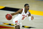 Maryland guard Darryl Morsell drives to the basket against Nebraska during the second half of an NCAA college basketball game, Tuesday, Feb. 16, 2021, in College Park, Md. Maryland won 64-50. (AP Photo/Julio Cortez)
