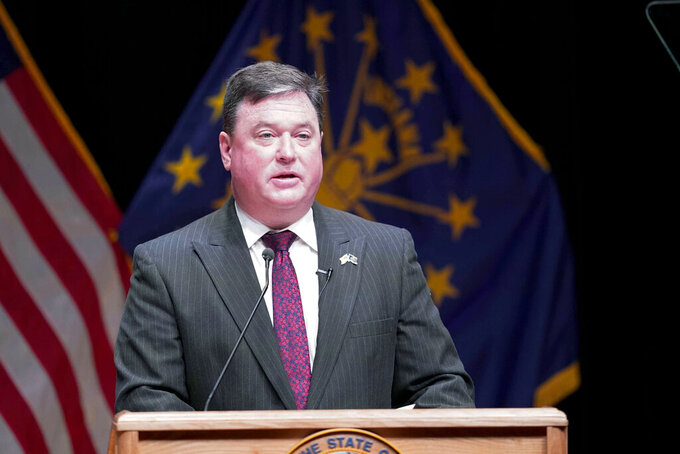 """FILE - In this Jan. 11, 2021 file photo, Indiana's attorney general Todd Rokita speaks, in Indianapolis. Indiana's attorney general took aim Friday, May 1, 2021, at Gov. Eric Holcomb's attempt to block anew law giving state legislators more authorityto intervene during public emergencies declared by the governor. A lawsuit filed by the Republican governor on Tuesday, April 27, 2001, challenged the law enactedover his vetotwo weeks ago giving legislative leaders the power to call the General Assembly into what it calls an """"emergency session."""" (AP Photo/Darron Cummings, File)"""