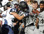New Hampshire safety Evan Horn, left, tackles Colorado running back Travon McMillian after a short gain in the first half of an NCAA college football game Saturday, Sept. 15, 2018, in Boulder, Colo. (AP Photo/David Zalubowski)