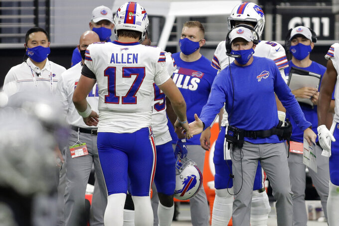 Buffalo Bills head coach Sean McDermott shakes hands with quarterback Josh Allen (17) after Allen scored a touchdown against the Las Vegas Raiders during the second half of an NFL football game, Sunday, Oct. 4, 2020, in Las Vegas. (AP Photo/Isaac Brekken)