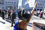 Equal Rights Amendment supporter, Sister Leona, dressed like the goddess Virtue wrapped in the Virginia State Flag greets legislators as they arrive for the 2020 session outside Virginia State Capitol in Richmond, Va., Wednesday, Jan. 8, 2020. (AP Photo/Steve Helber)