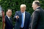 FILE - In this June 1, 2018, file photo, President Donald Trump, center, talks with Kim Yong Chol, left, former North Korean military intelligence chief and one of leader Kim Jong Un's closest aides, and Secretary of State Mike Pompeo as they walk from their meeting in the Oval Office of the White House in Washington. In recent weeks it's become clear that Donald Trump wants to meet with Kim Jong Un again, and the North Korean leader has told the White House he'd like more face-to-face talks with the American president. (AP Photo/Andrew Harnik, File)