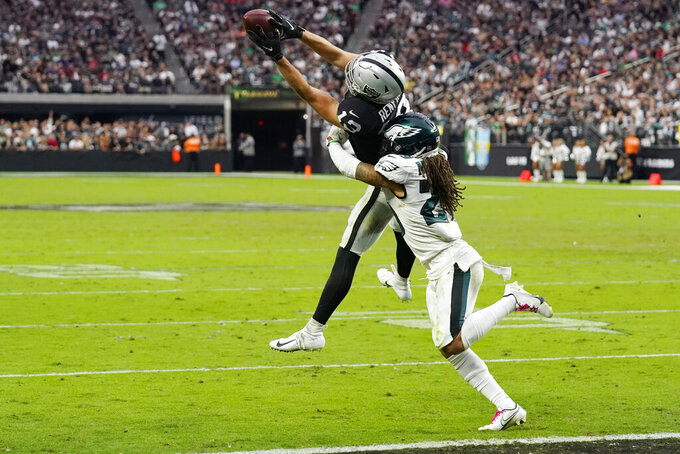 Las Vegas Raiders wide receiver Hunter Renfrow (13) catches a pass over Philadelphia Eagles free safety Avonte Maddox (29) during the second half of an NFL football game, Sunday, Oct. 24, 2021, in Las Vegas. (AP Photo/Rick Scuteri)