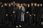Designer Giorgio Armani, centre, accepts applause at the conclusion of the Emporio Armani men's Fall-Winter 2020/21 collection, that was presented in Milan, Italy, Saturday, Jan. 11, 2019. (AP Photo/Luca Bruno)