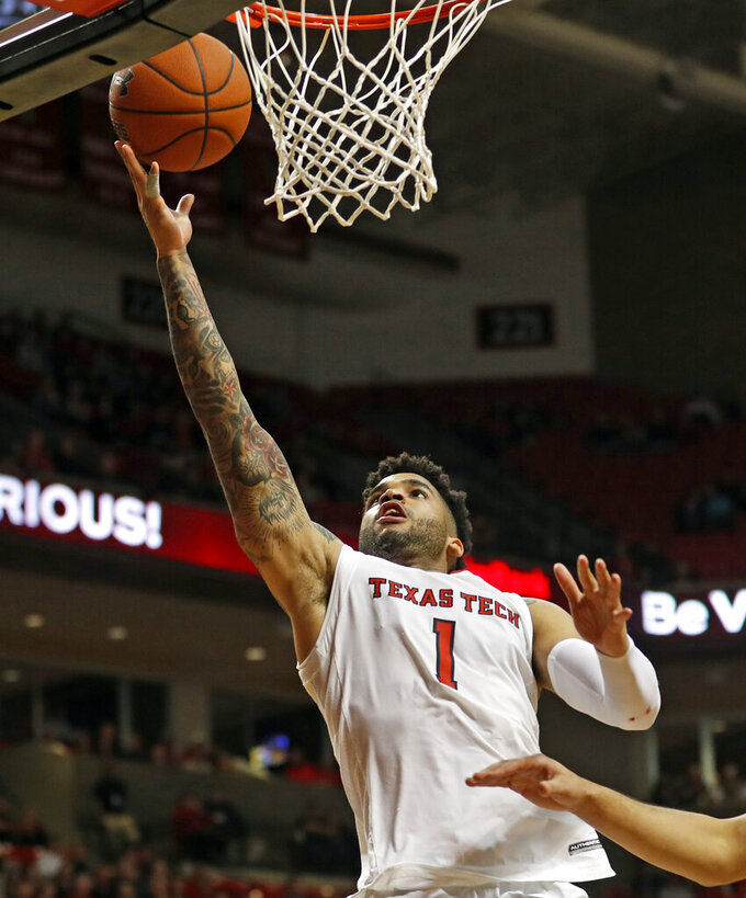 Texas Tech's Brandone Francis (1) lays up the ball during the second half of an NCAA college basketball game against West Virginia, Monday, Feb. 4, 2019, in Lubbock, Texas. (AP Photo/Brad Tollefson)