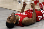 Indiana 's Aljami Durham (1) reacts after scoring a basket against the Ohio State during the first half of an NCAA college basketball game in the second round of the Big Ten Conference tournament, Thursday, March 14, 2019, in Chicago. (AP Photo/Nam Y. Huh)