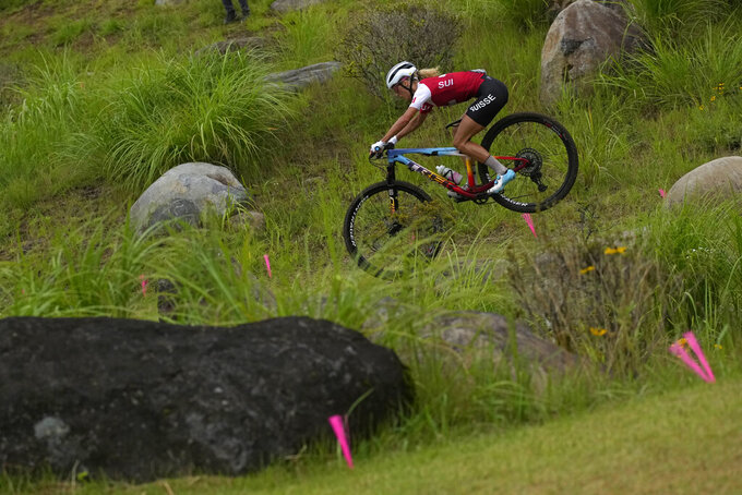Jolanda Neff of Switzerland competes during the women's cross-country mountain bike competition at the 2020 Summer Olympics, Tuesday, July 27, 2021, in Izu, Japan. (AP Photo/Christophe Ena)