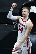 Wisconsin's Brad Davison celebrates as he leaves the court following an NCAA college basketball game against Penn State at the Big Ten Conference tournament, Thursday, March 11, 2021, in Indianapolis. Wisconsin won 75-74. (AP Photo/Darron Cummings)