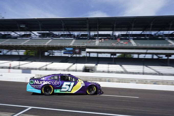 Cody Ware drives on pit lane during practice for the NASCAR Cup Series auto race at Indianapolis Motor Speedway, Saturday, Aug. 14, 2021, in Indianapolis. (AP Photo/Darron Cummings)