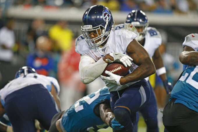 Tennessee Titans running back Derrick Henry, center, runs past Jacksonville Jaguars linebacker Najee Goode, lower left, for a 1-yard touchdown during the second half of an NFL football game, Thursday, Sept. 19, 2019, in Jacksonville, Fla. (AP Photo/Stephen B. Morton)