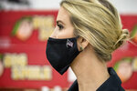 Ivanka Trump, the daughter of President Donald Trump, wears an American flag pin on her mask as she tours Coastal Sunbelt Produce, Friday, May 15, 2020, in Laurel, Md. (AP Photo/Andrew Harnik)