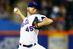 New York Mets pitcher Zack Wheeler throws during the third inning of the team's baseball game against the Miami Marlins on Friday, May 10, 2019, in New York. (AP Photo/Adam Hunger)