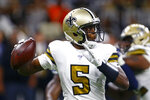 New Orleans Saints quarterback Teddy Bridgewater (5) drops back to pass in the first half of an NFL football game against the Dallas Cowboys in New Orleans, Sunday, Sept. 29, 2019. (AP Photo/Butch Dill)