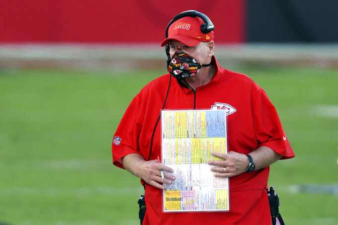 Kansas City Chiefs head coach Andy Reid wears a protective face mask during the first half of an NFL football game against the Tampa Bay Buccaneers Sunday, Nov. 29, 2020, in Tampa, Fla. (AP Photo/Jason Behnken)