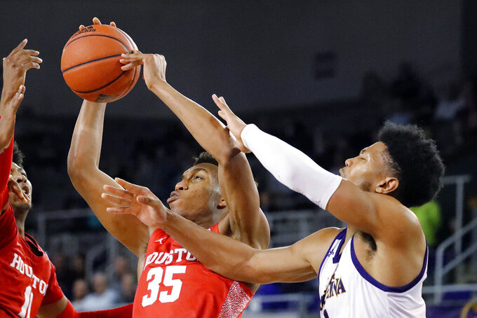 Houston's Fabian White Jr. (35) grabs a rebound next to East Carolina's Jayden Gardner (1) during the second half of an NCAA college basketball game in Greenville, N.C., Wednesday, Jan. 29, 2020. (AP Photo/Karl B DeBlaker)