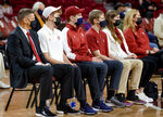 University of Oklahoma's new men's NCAA college basketball coach Porter Moser, left, sits with his family during his introductory press conference at Lloyd Noble Center in Norman, Okla., Wednesday, April 7, 2021. (Chris Landsberger/The Oklahoman via AP)