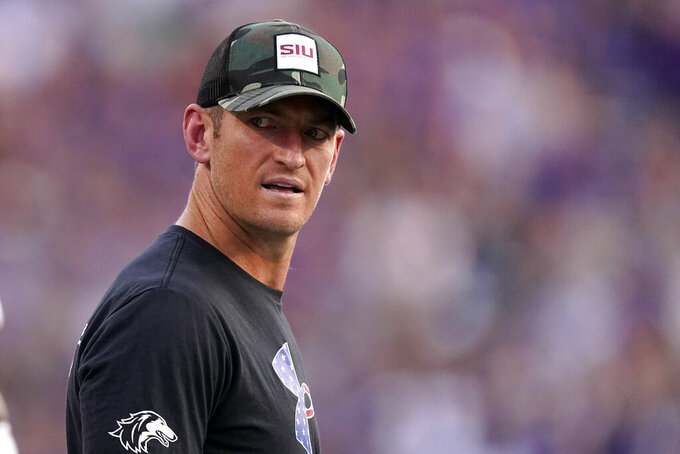 Southern Illinois head coach Nick Hill watches during the first half of an NCAA college football game against Kansas State, Saturday, Sept. 11, 2021, in Manhattan, Kan. (AP Photo/Charlie Riedel)